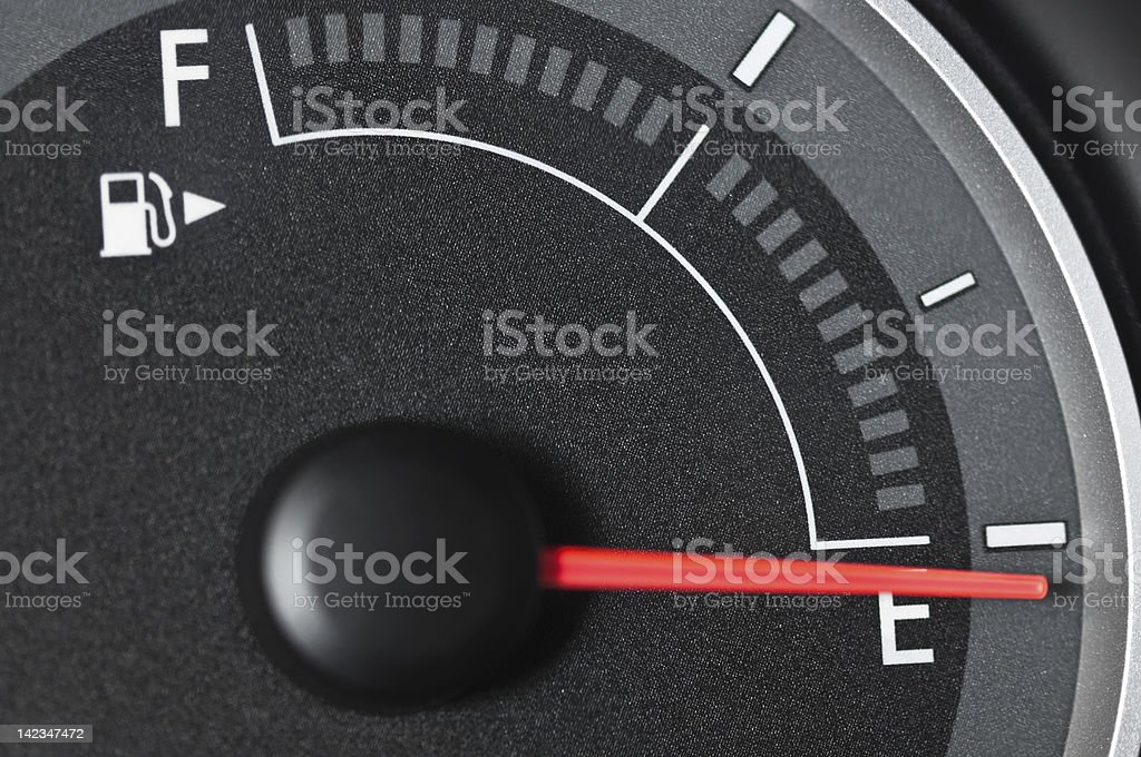 Fuel Gauge with needle at empty stock photo