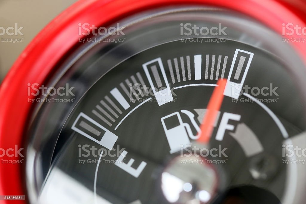 Fuel gauge with warning indicating quantity fuel tank. stock photo