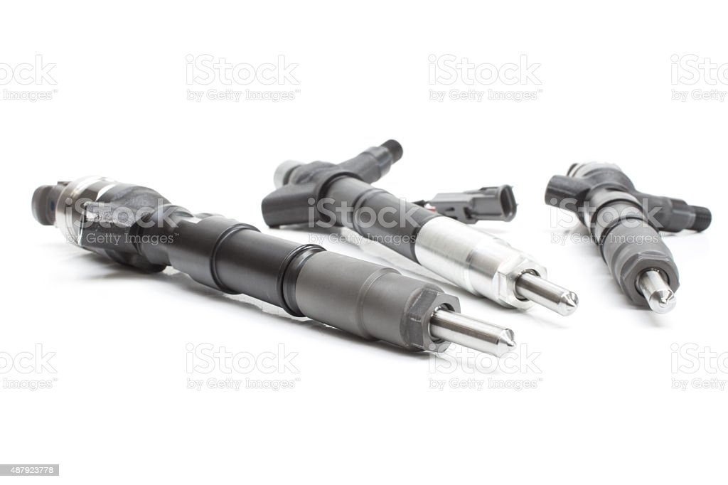 Fuel injector into the combustion chamber of the engine stock photo