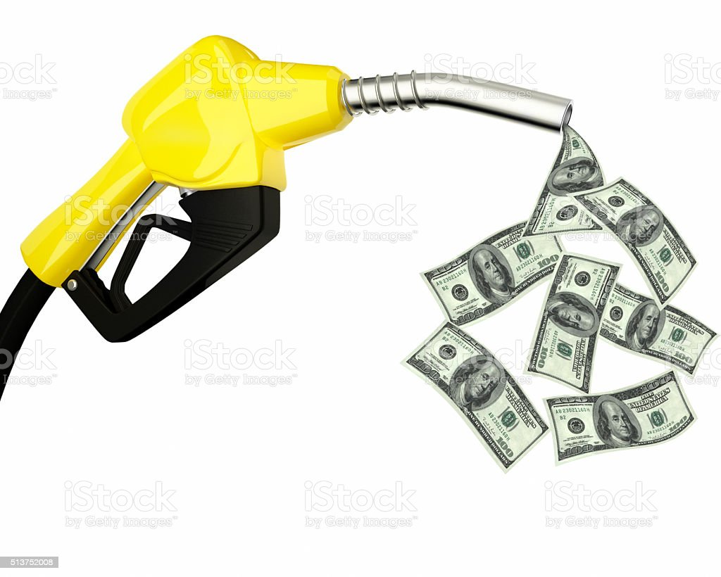 fuel nozzle with dollars flying around stock photo