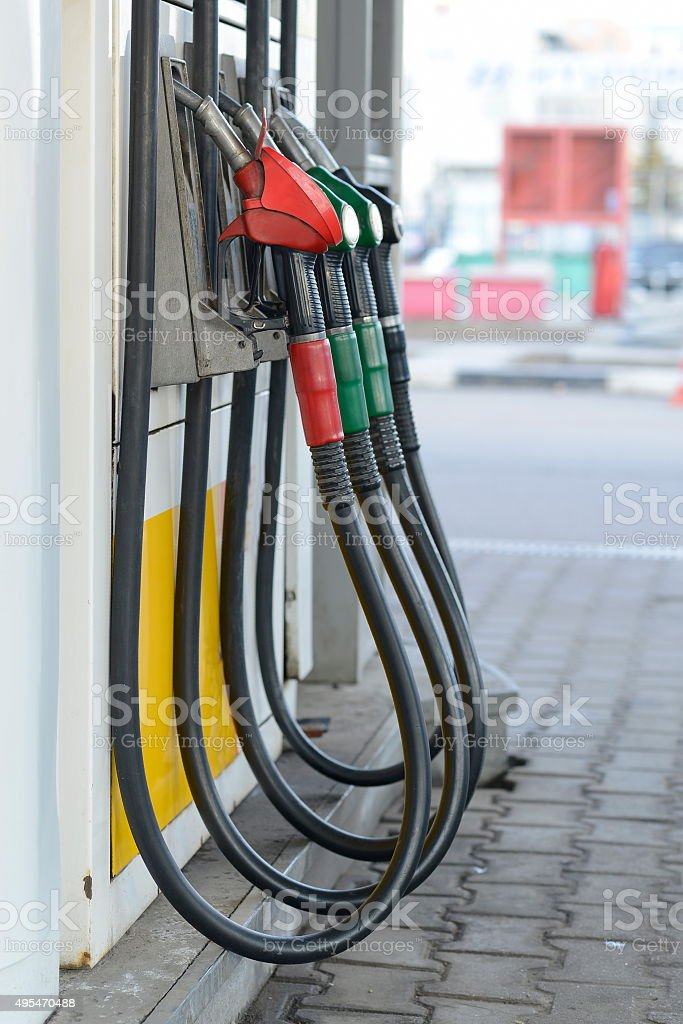 Fuel nozzles at a gas station. stock photo