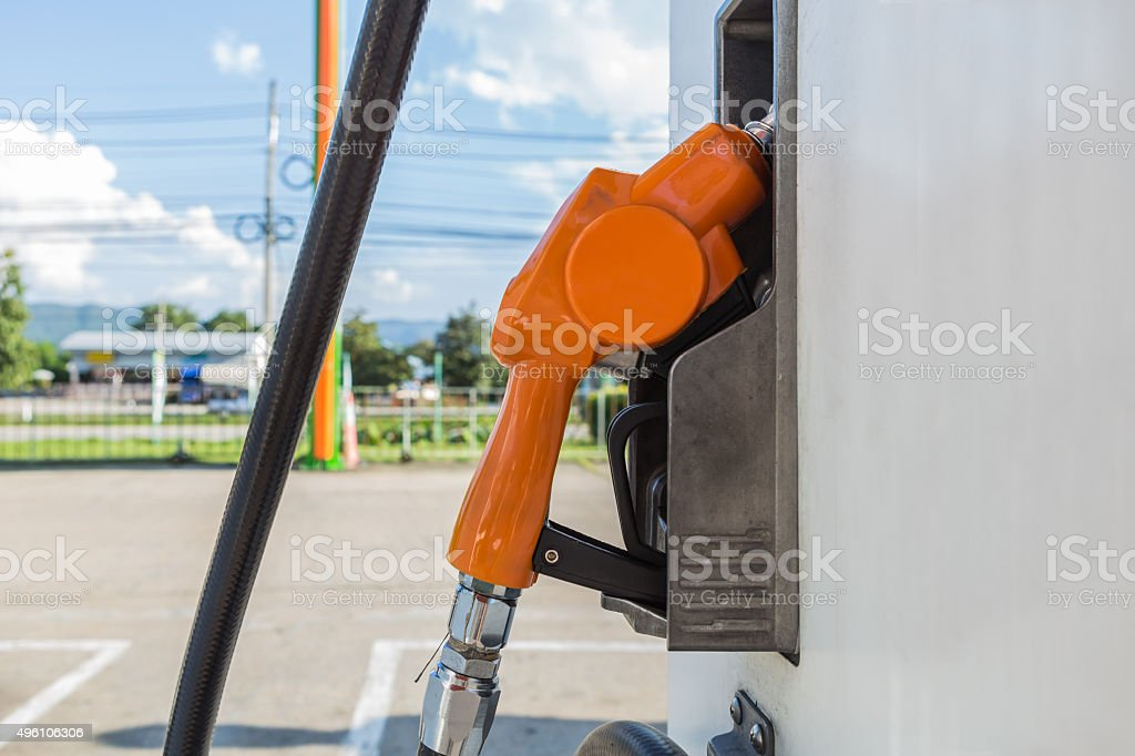 Fuel oil dispenser at petrol filling station. stock photo