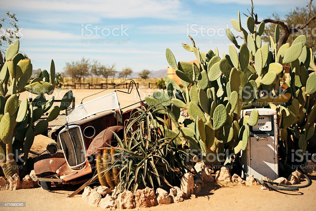 Fuel Pump and Car Wreck at Solitaire in Namibian Desert stock photo