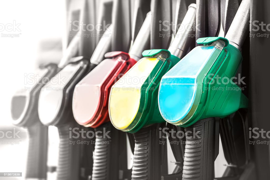 Fuel pump nozzles close up in a service station stock photo