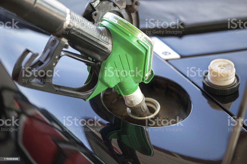 Fuel pump nozzles close up stock photo