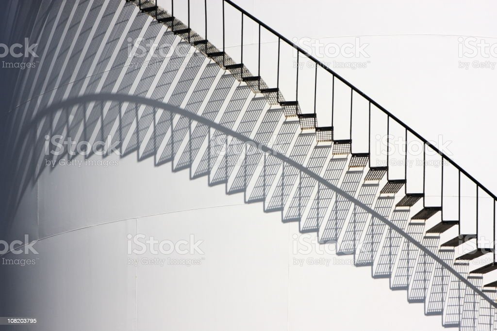 Fuel Storage Tank Refinery Spiral Staircase stock photo