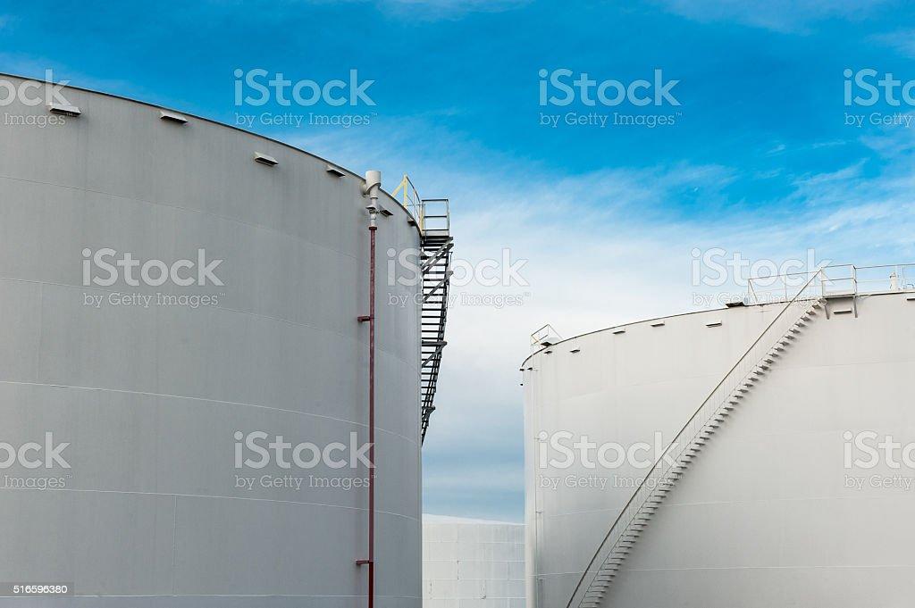 Fuel storage tanks with a blue sky stock photo