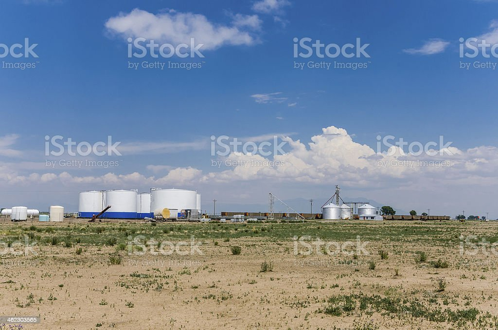 Fuel Tanks and Grain Silos along a Railway stock photo