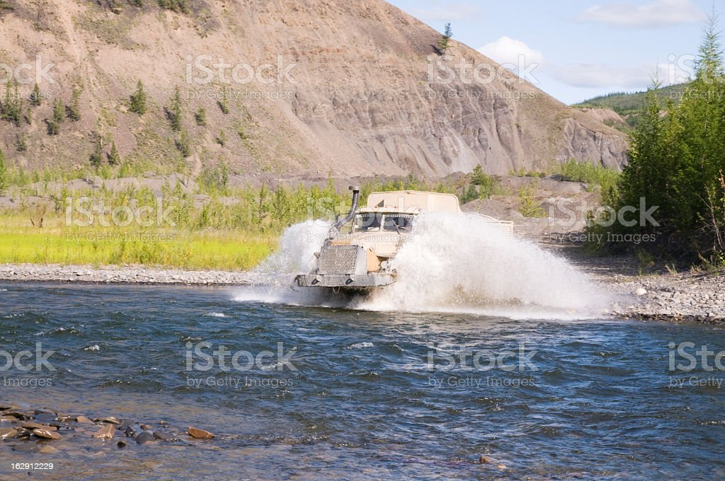Fuel truck moving in the river. royalty-free stock photo