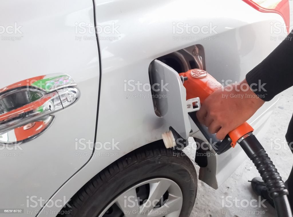 fueling cars stock photo