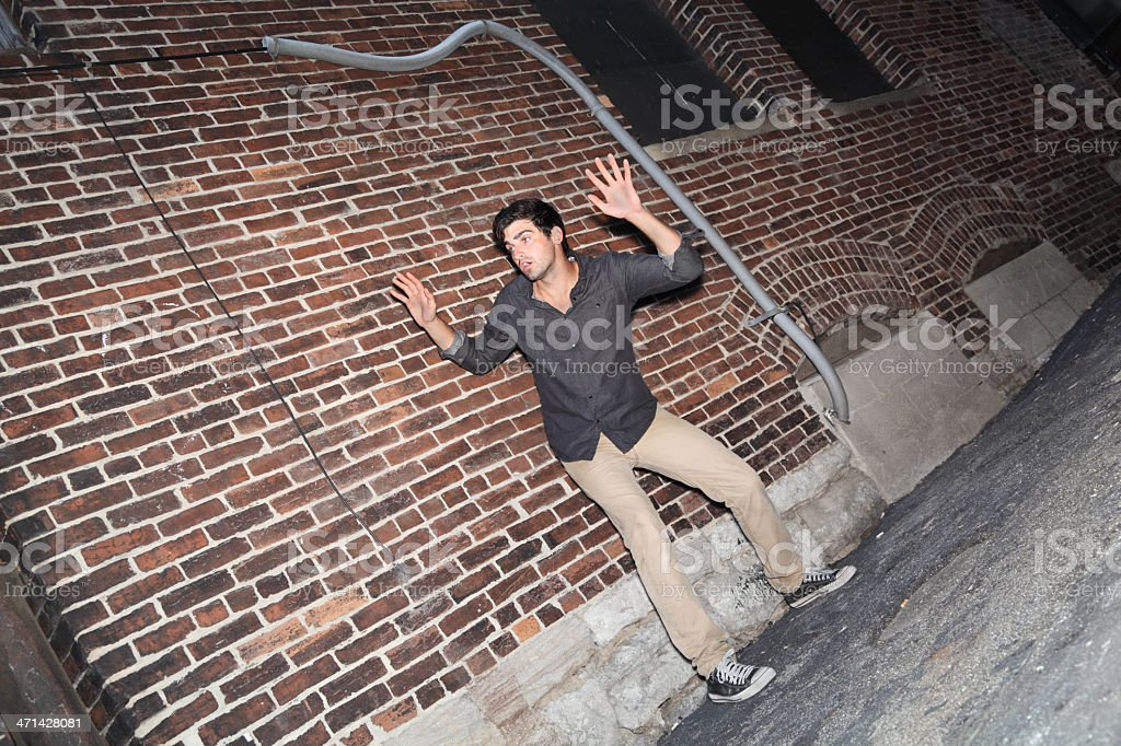 fugitive in alleyway captured on camera stock photo