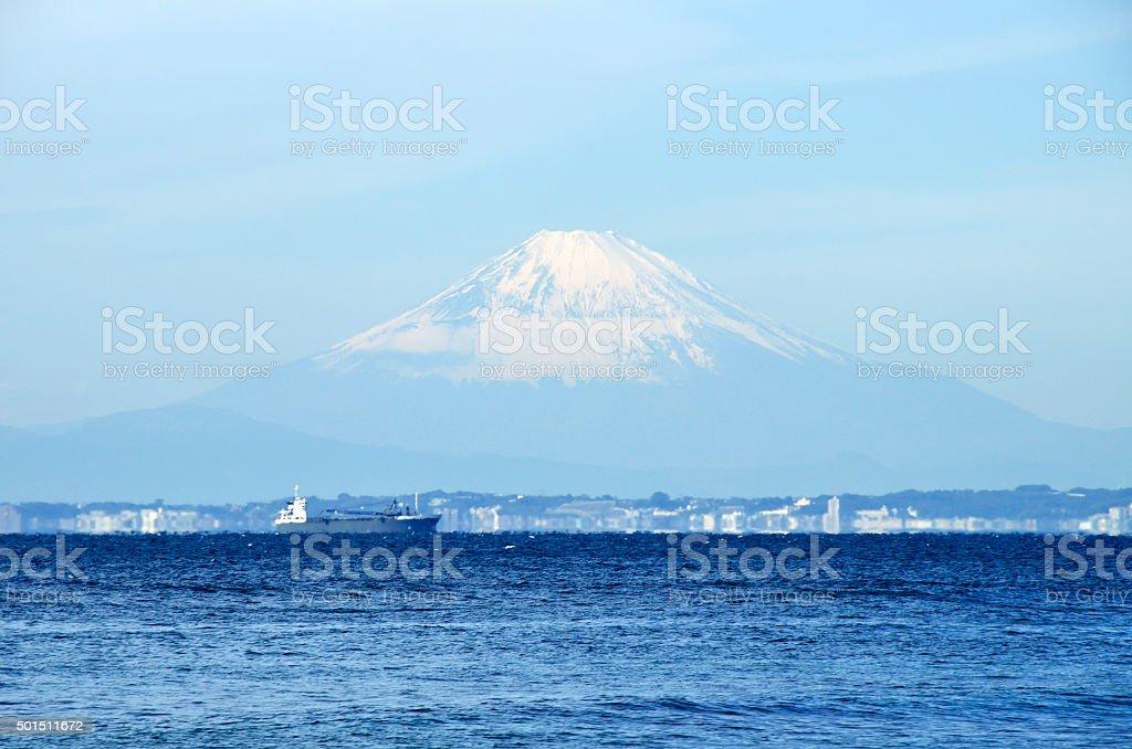 Fuji beyond the horizon stock photo