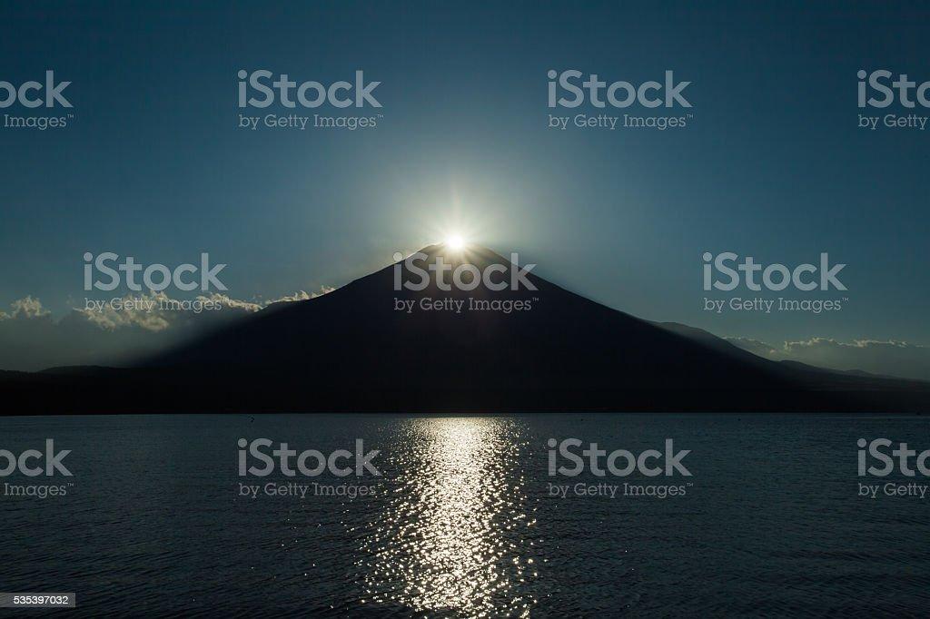 Fuji diamond , Sunset on Top of Mountain Fuji and refection stock photo