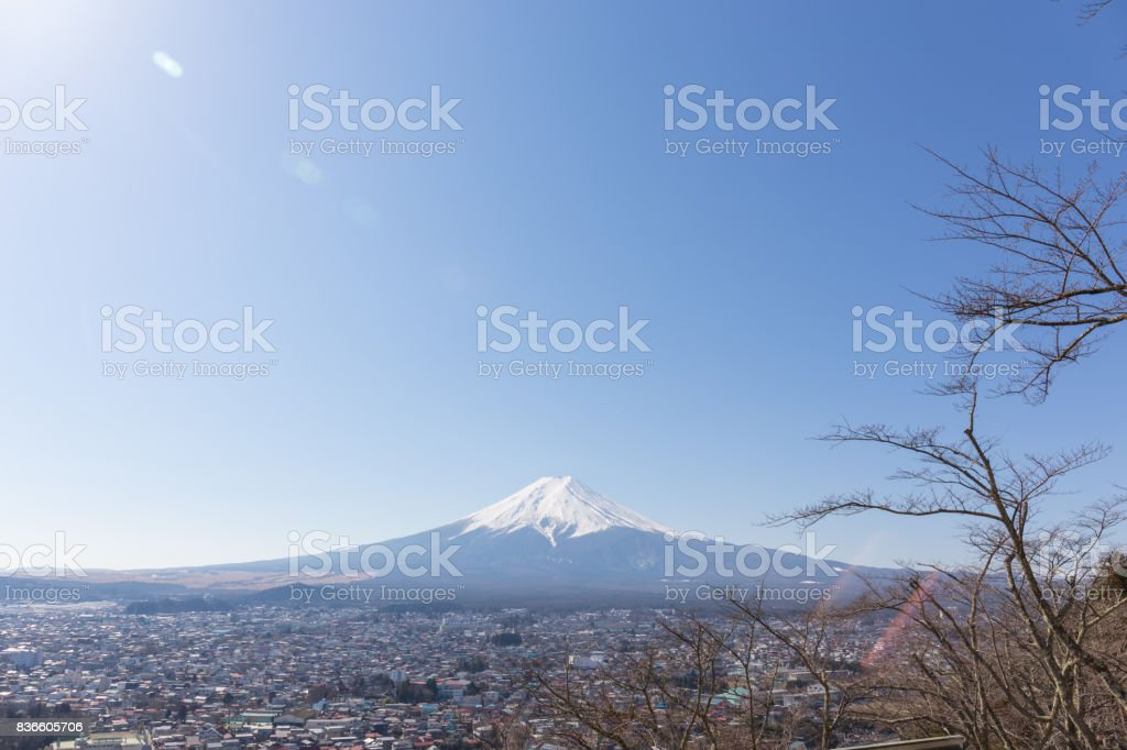 Fuji mountain with blue sky and len flares on up left