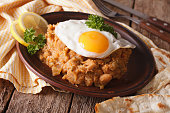 ful medames with a fried egg and pita closeup. horizontal