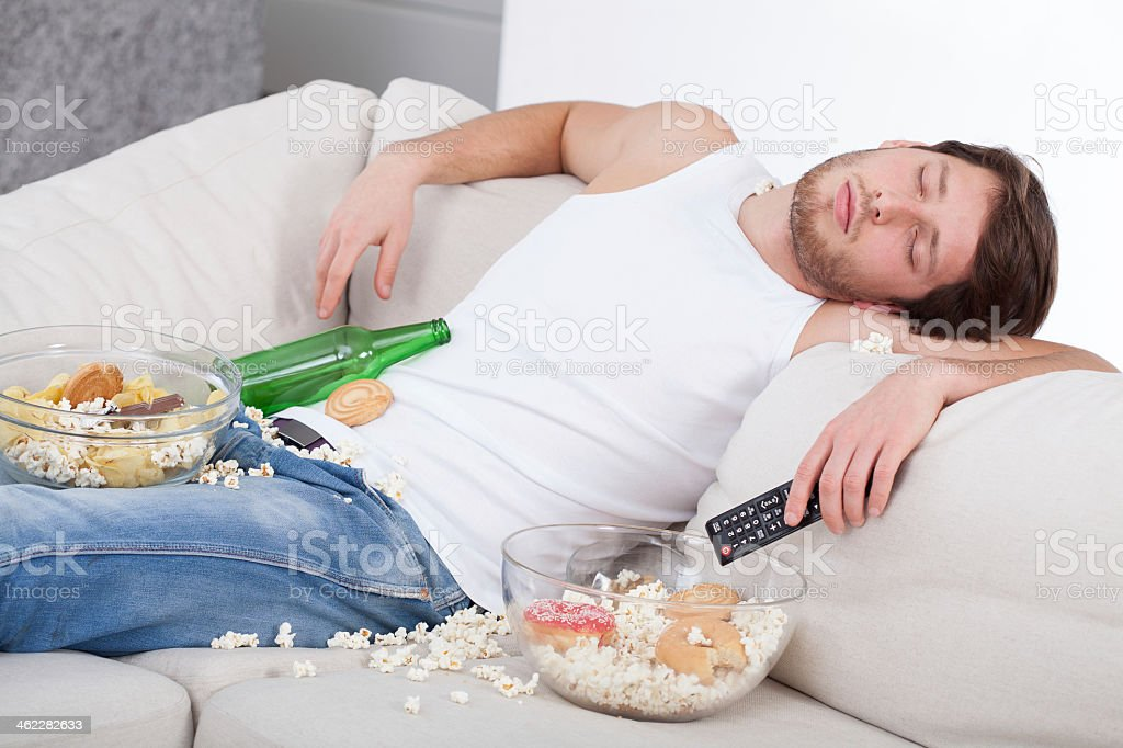 Full and drunk man stock photo