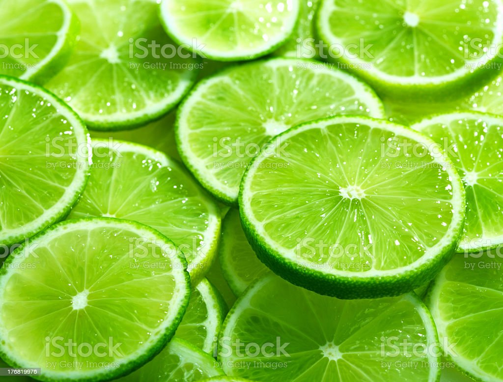 Full background of vibrant green lime slices royalty-free stock photo