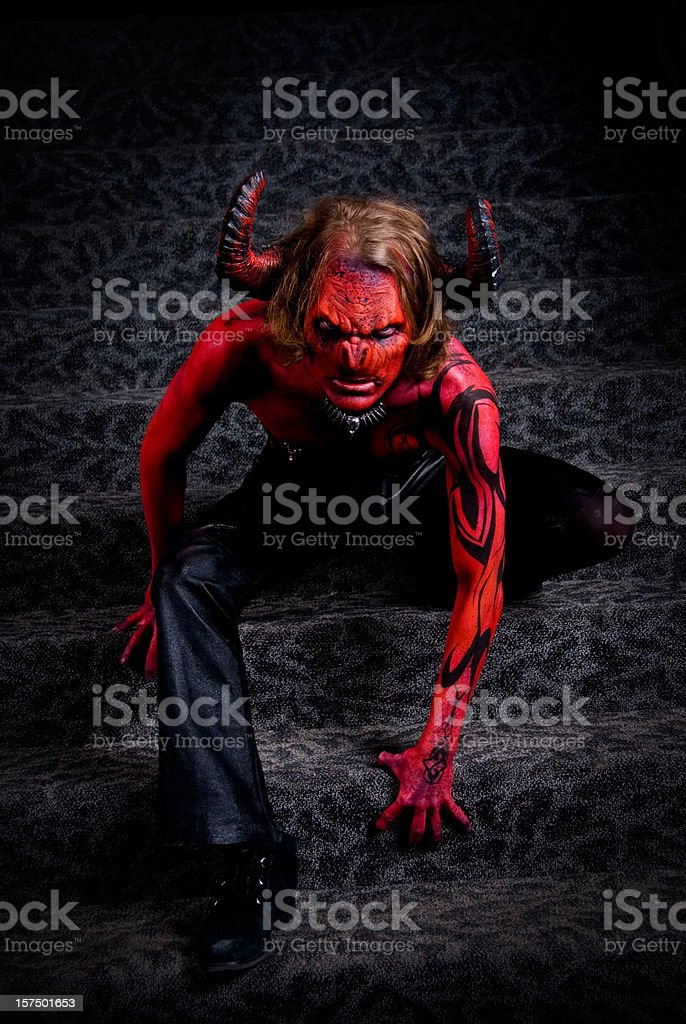 Full body image of a man in devil's costume royalty-free stock photo