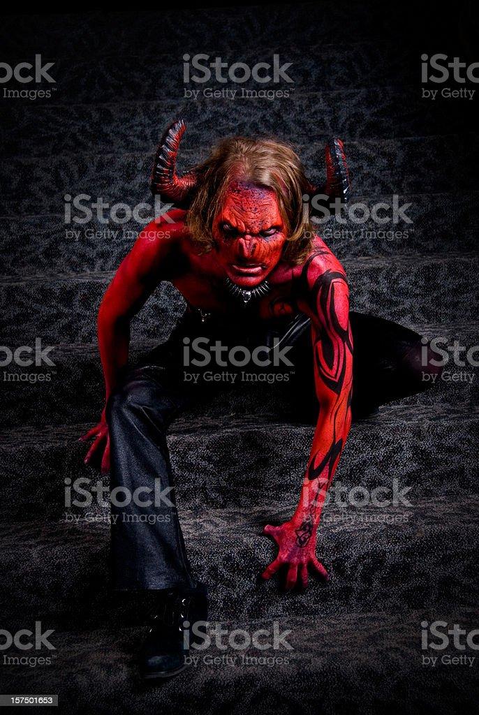 Full body image of a man in devil's costume stock photo