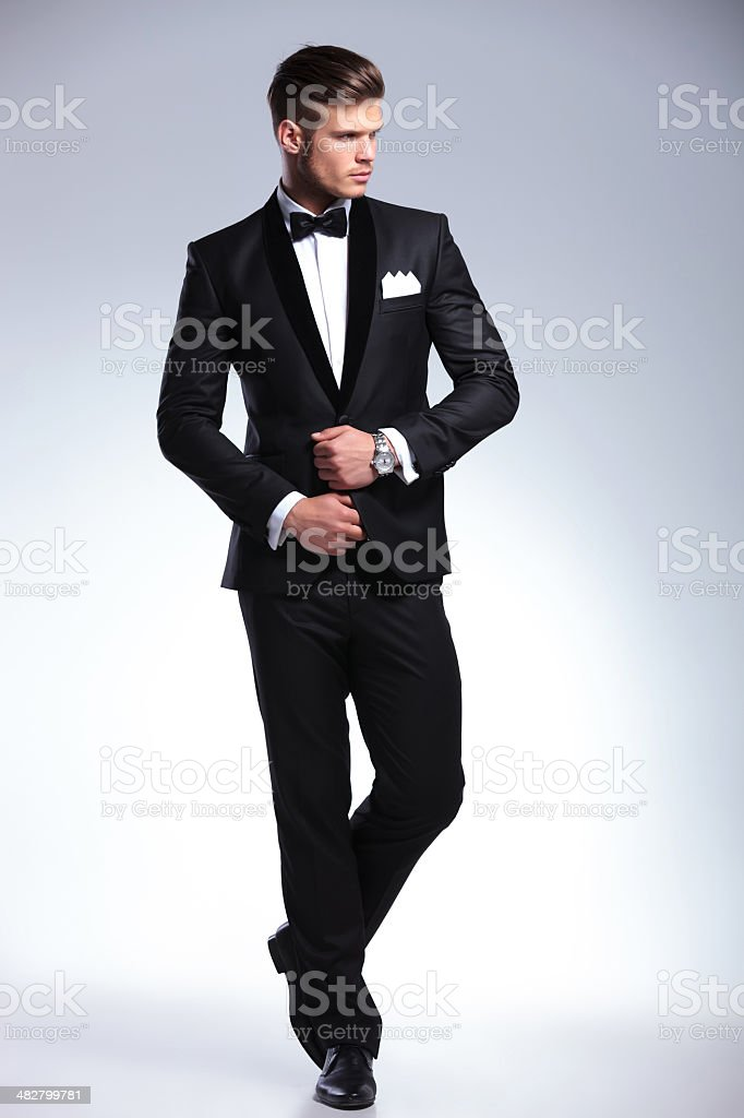 full body of a business man looking away stock photo
