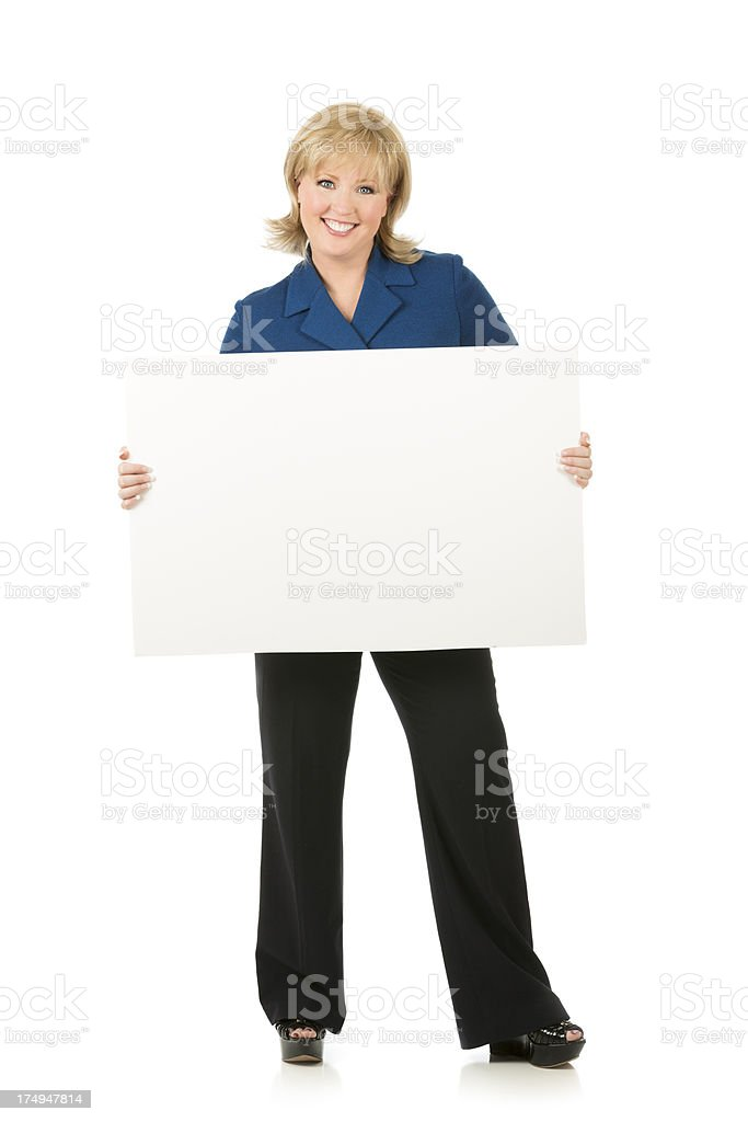 Full body portrait of a businesswoman holding blank sign royalty-free stock photo
