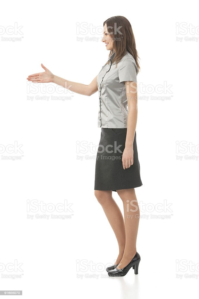 Full body portrait of businesswoman giving hand for handshake, isolated royalty-free stock photo