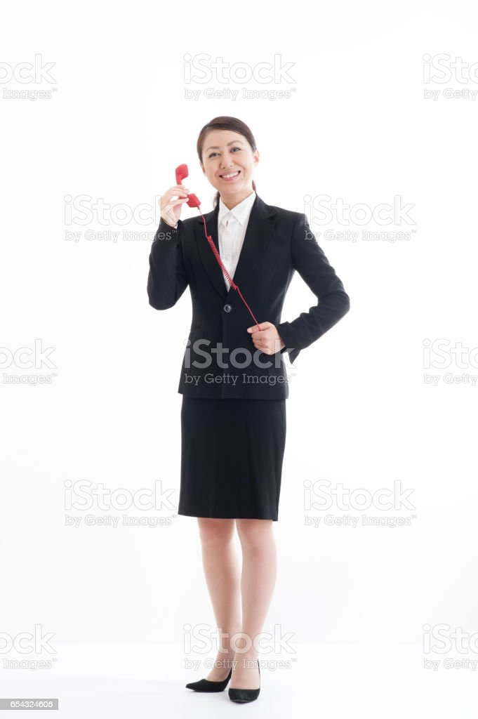 Full body portrait of Red hook to have Japanese businesswoman stock photo