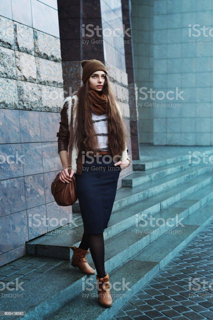 Full body portrait of young beautiful fashionable woman wearing stylish stock photo