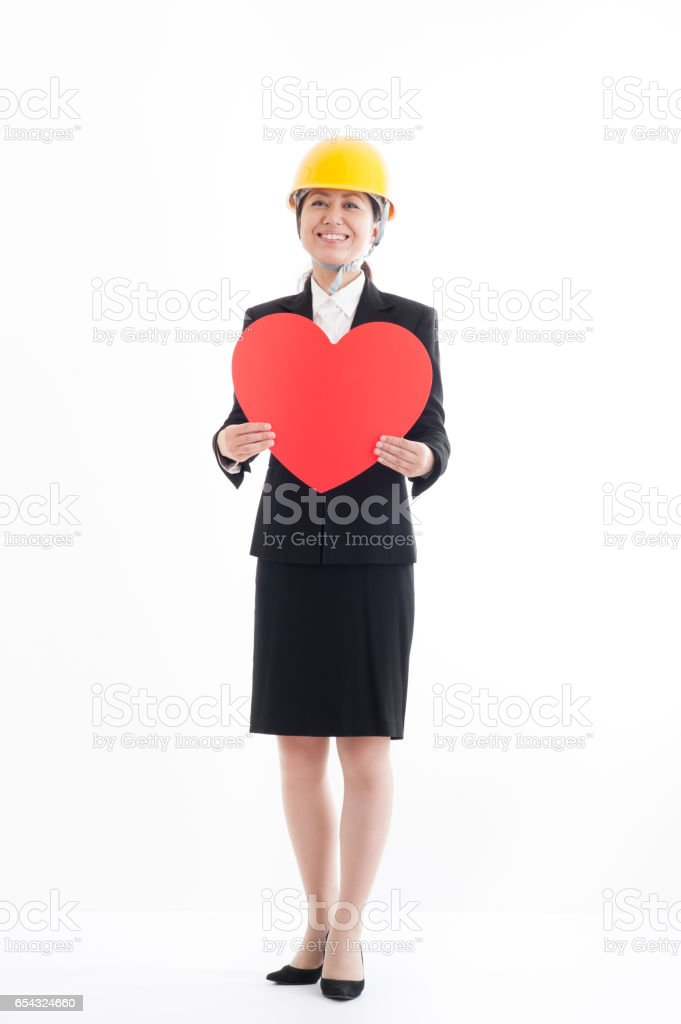 Full body portrait, wearing a helmet with a red heart Japanese business woman stock photo