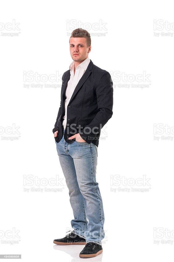 Full body shot of attractive young man with jacket and stock photo