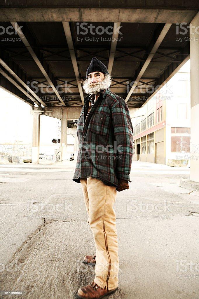 Full Body Shot of Older Homeless Man stock photo