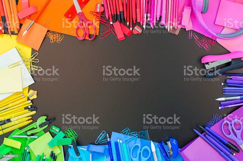 Full border of multi colored school supplies stock photo