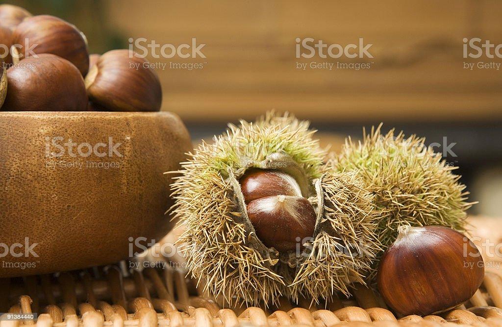 Full bowl of premium chestnuts royalty-free stock photo