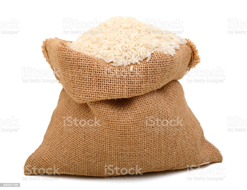 full burlap with white rice stock photo