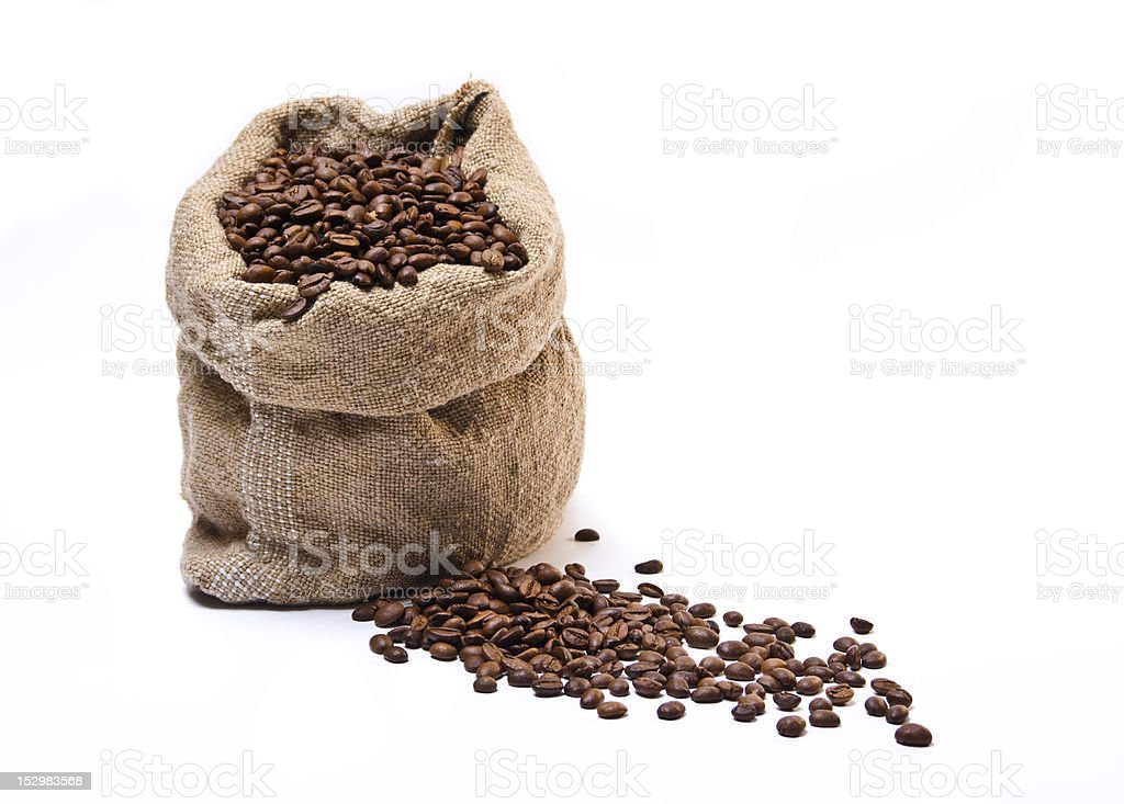 Full coffee beans sack with some scattered royalty-free stock photo