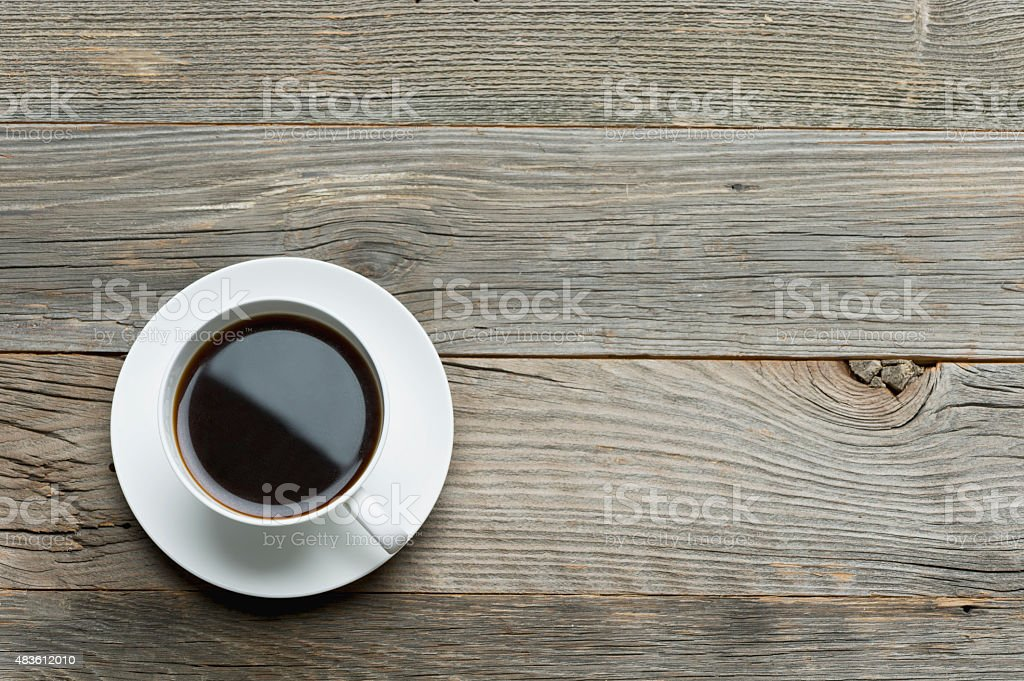 Full Coffee cup on a wooden table. stock photo