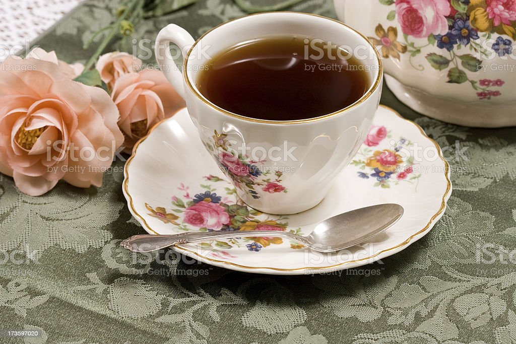 Full cup of tea on a saucer stock photo