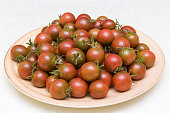 Full dish with fresh cherry tomatoes. Food background. Healthy eating.