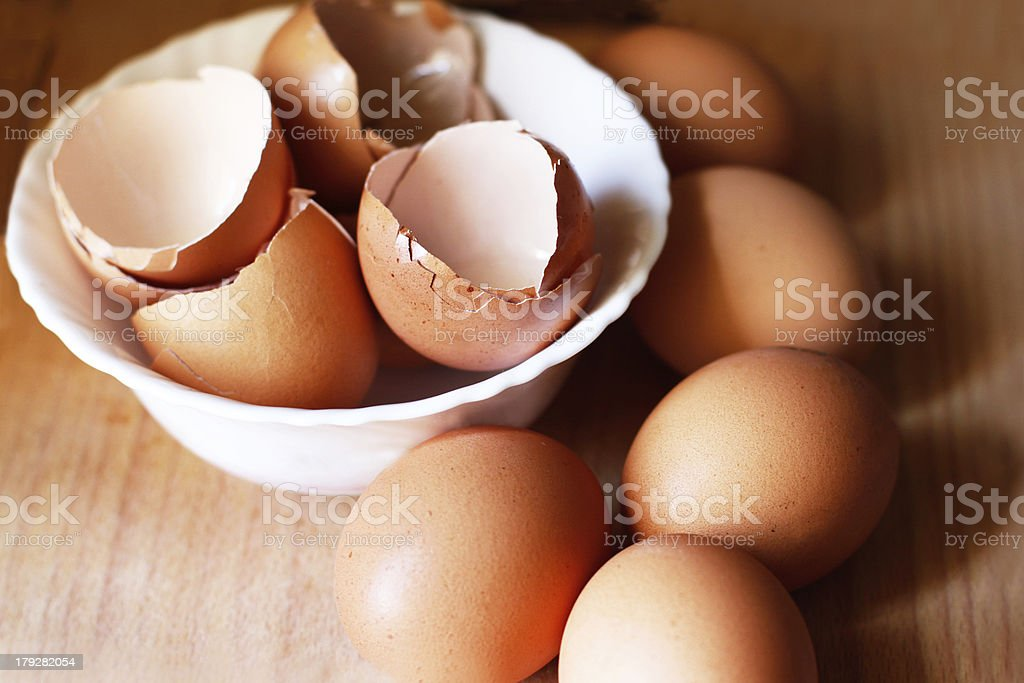 Full eggs and empty ones in the white bowl royalty-free stock photo
