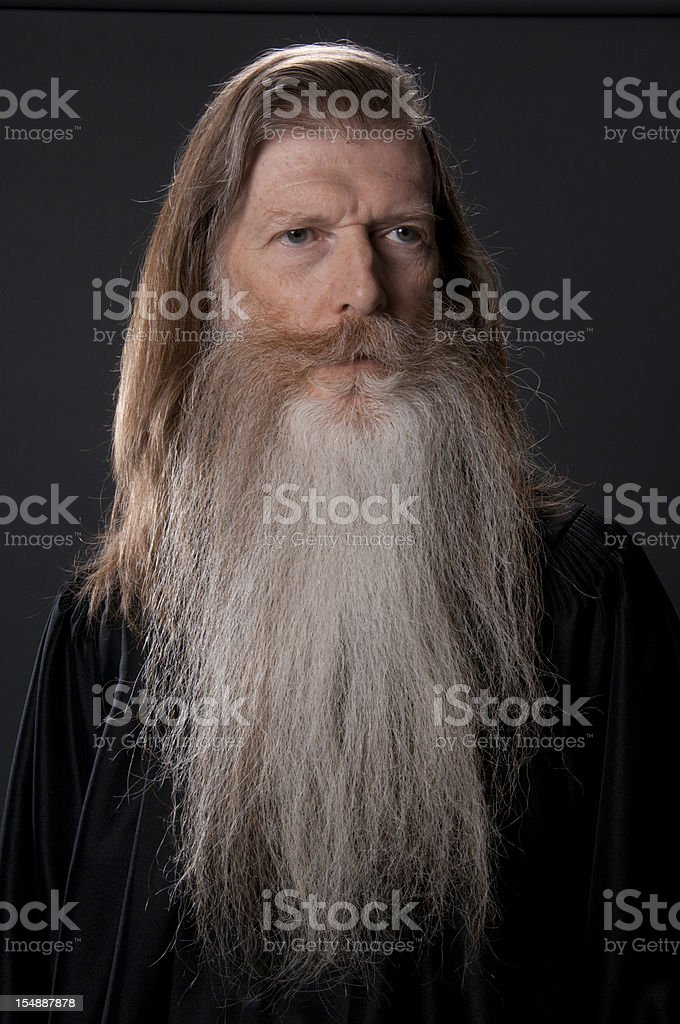 Full face of long bearded man in black robe-isolated stock photo
