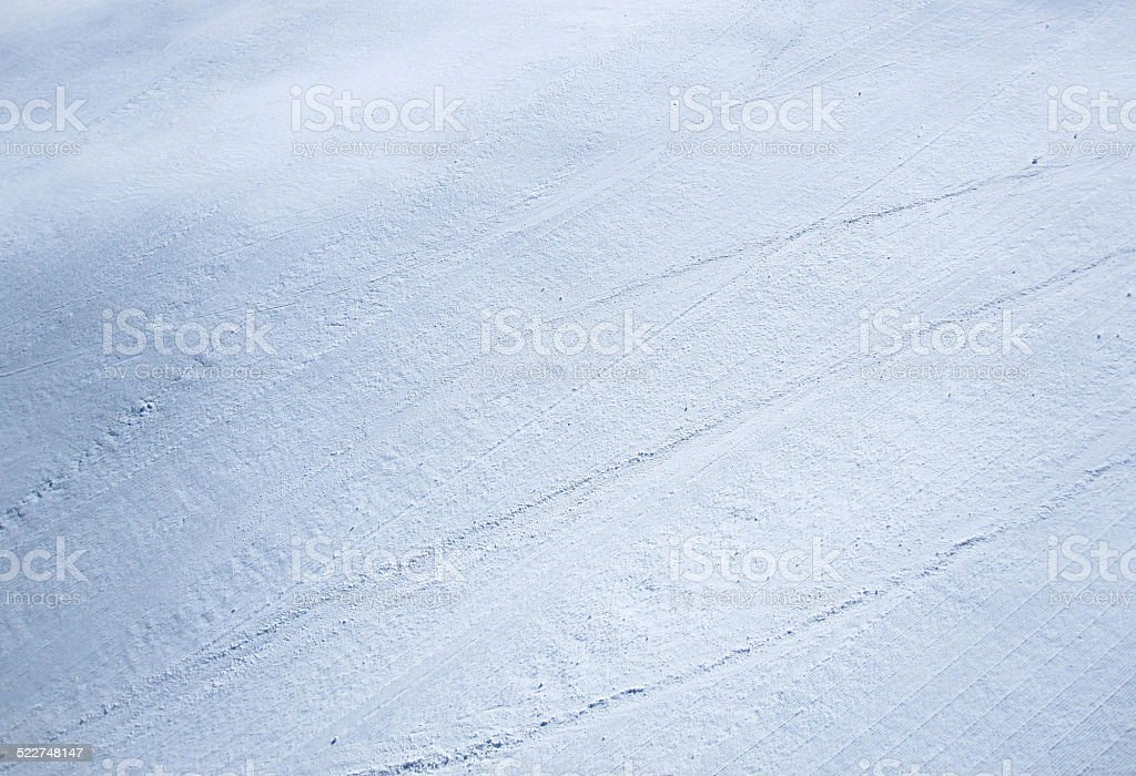Full frame groomed snow on a ski hill stock photo