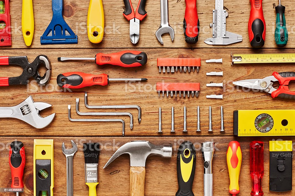 Full frame shot of various hand tools arranged on wood stock photo