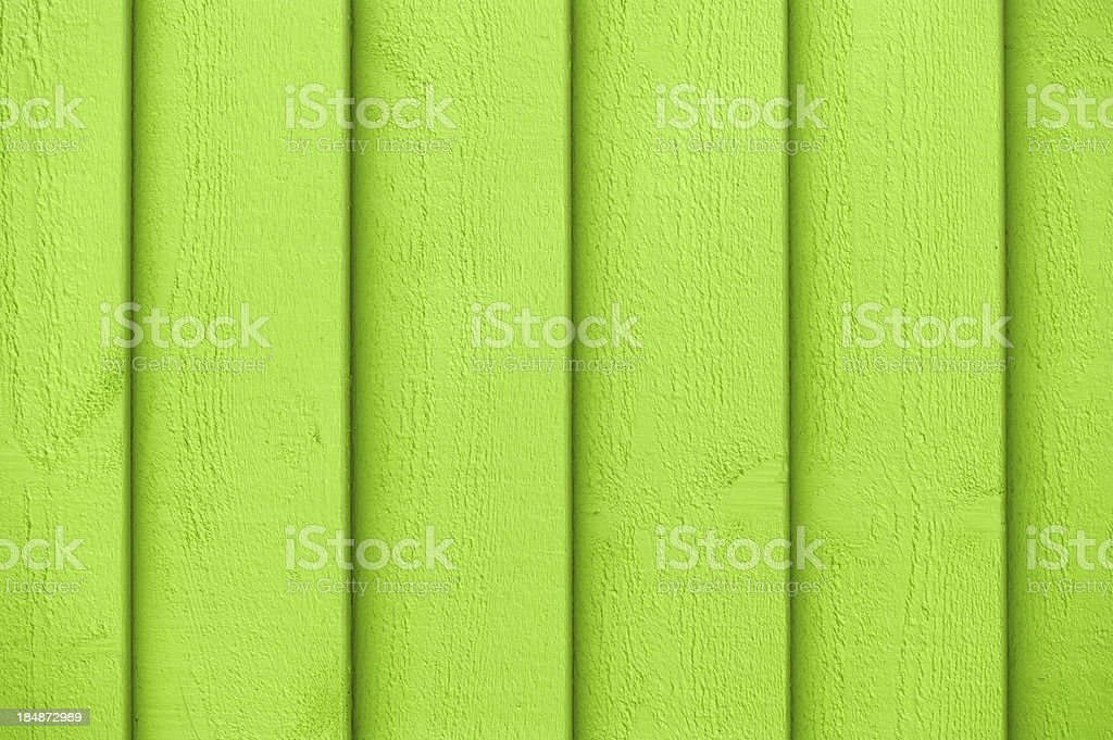 Full frame view of green paint on the wooden wall royalty-free stock photo
