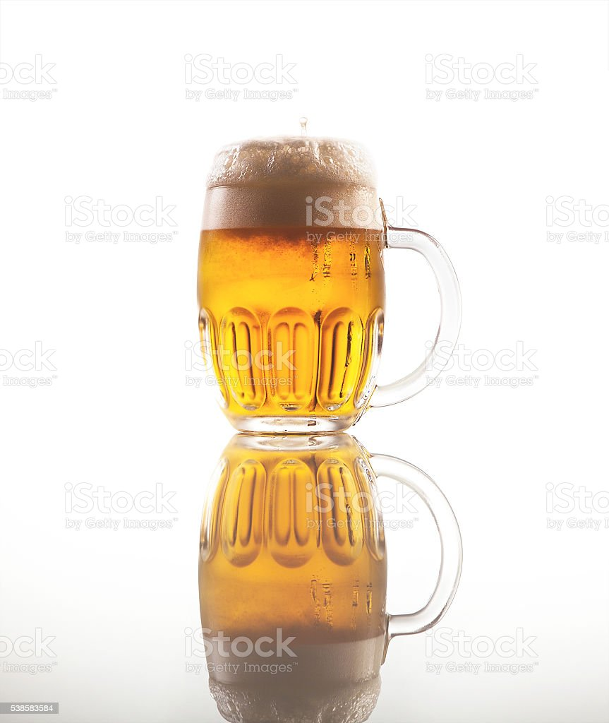 Full glass of beer with foam stock photo