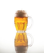 Full glass of beer with foam