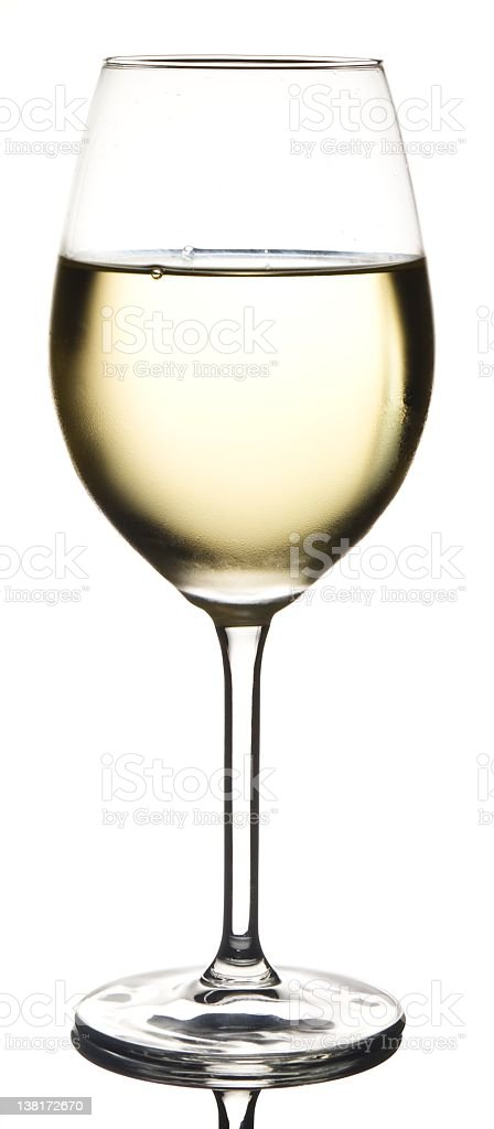 Full glass of cold white wine royalty-free stock photo