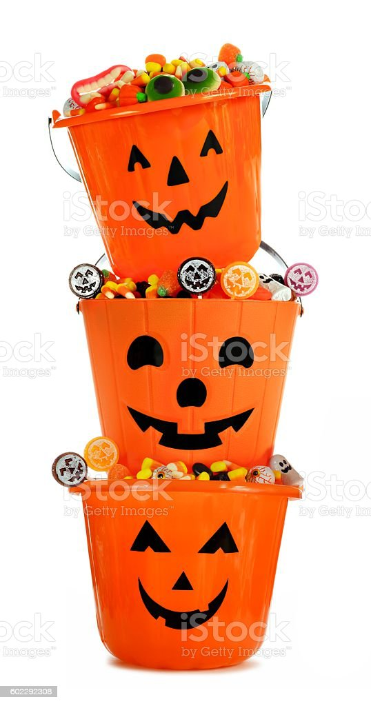 Full Halloween Jack o Lantern candy holders stacked over white stock photo
