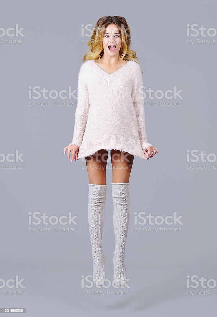 Full height portrait of a gorgeous woman jumping stock photo