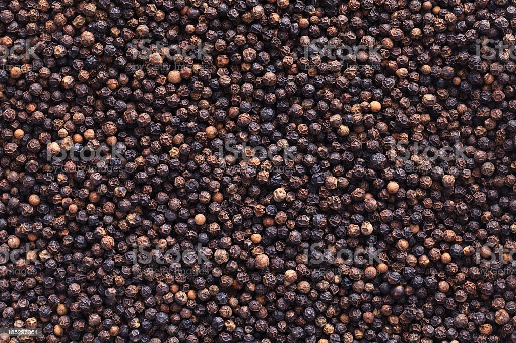 Full image of peppercorns as a background stock photo