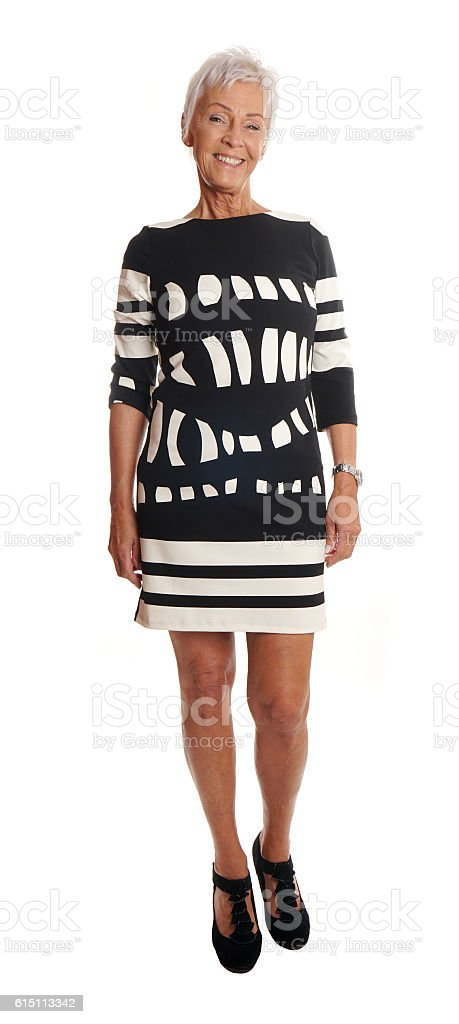 full lenght front view of senior woman stock photo